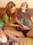Two lesbian teenies kissing