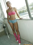 Amazing Thai girl dressed in pink and posing on the stairs