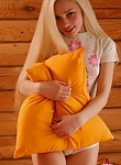 Cute blonde teen playing with her pillows